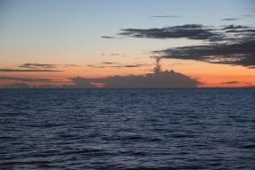 "This was taken from the Thomson Celebration Ship in April 2014.  It is simply ""cloud formation"", but what are the chances of a cloud looking like a ship on the horizon!!!"