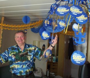 Husbands 60th birthday sailed Norweign fjords APRIL RCI decorated his cabin
