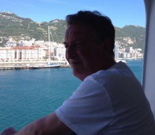 My lovely hubby enjoying the view from our balcony X