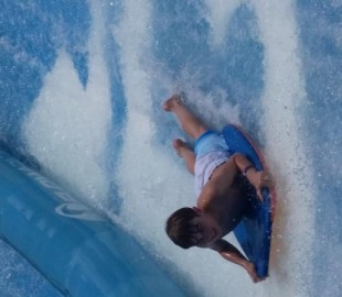 Our son trying out the Flowrider