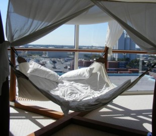 One of the wonderful double secluded deck hammocks on board