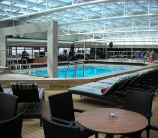 The Lido pool, roof closed, on ms Eurodam. There are private cabanas down the side of this area so you dont have to mix with the other passengers...it looks a bit odd to me.