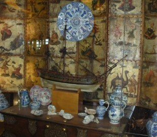 China cabinet opposite the Rembrandt dining room, ms Eurodam, containing Delftware from a Chinese shipwreck.