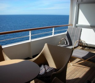 Big balcony to a Neptune Suite on Ryndam, heading towards Shetland.