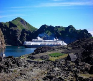 Ryndam at anchor inside the lava flows in Heimaey, Westman Islands, off the coast of Iceland.