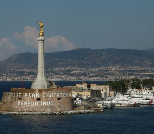 Messina port entrance with mainland Italy behind in the distance