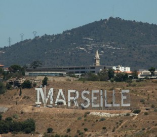 Marseille written in letters overlooking the port