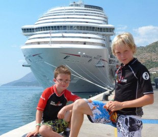 My two sons Aaron and Bradley with Carnival Magic in the background at Dubrovnik Croatia