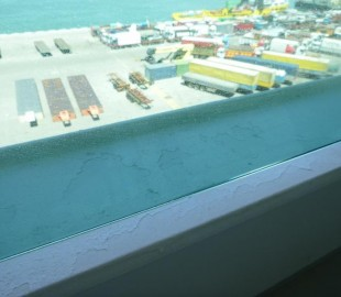 Peeling paint on balcony ledge