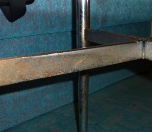 Table legs covered in rust in stateroom