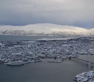 Looking down at Fred Olsen`s Boudicca from the mountain that over looks Tromso in Northern Norway in March 2012