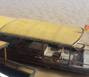 The ship almost never docked along the Mekong - Instead we were tendered to shore by these river boats