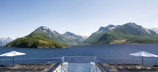 Infinity Pool with fjords background
