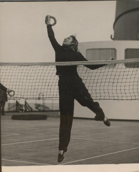 Woman playing tennis on a cruise ship