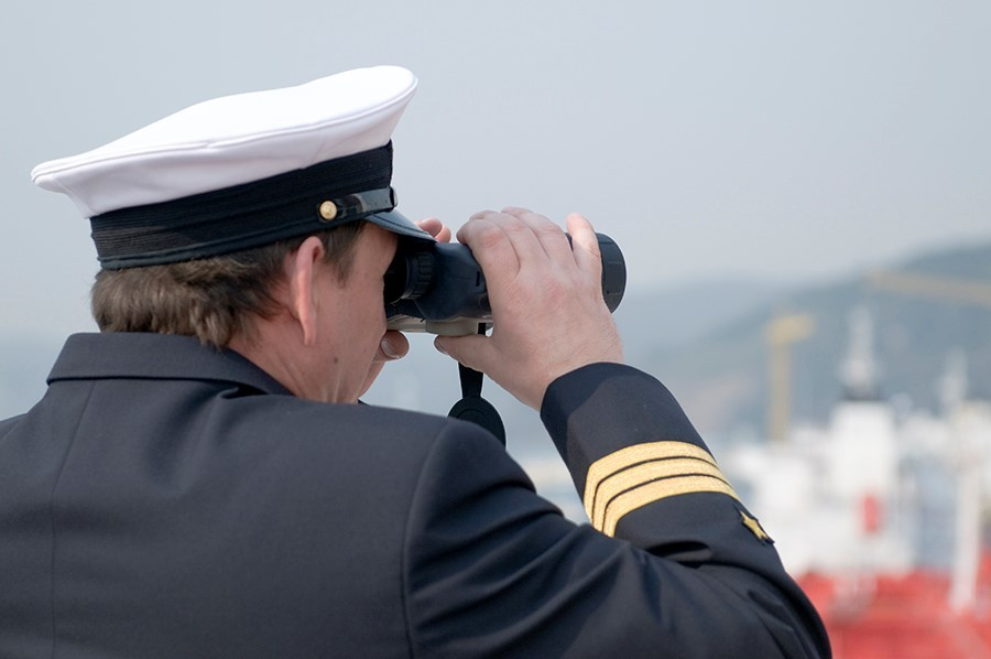 Captain looking through binoculars