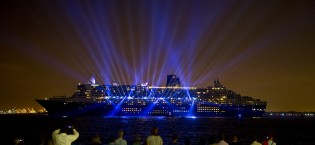 Cunard's flagship Queen Mary 2 departs from New York with a theatrical light and music show after completing her 175th Anniversary tour, Tuesday, July 14, 2015.  This month marks the 175th Anniversary of Cunard, and Queen Mary 2 has recreated the historic Transatlantic Crossing from Liverpool to Halifax and Boston made by the RMS Britannia in July 1840.   Although not a port of call in the original crossing made by Britannia, New York has been Cunard's North American home port for over a century.  (Photo by Diane Bondareff/AP Images for Cunard)