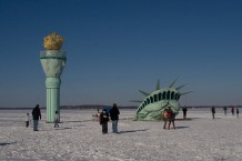 tatue of liberty covered in snow