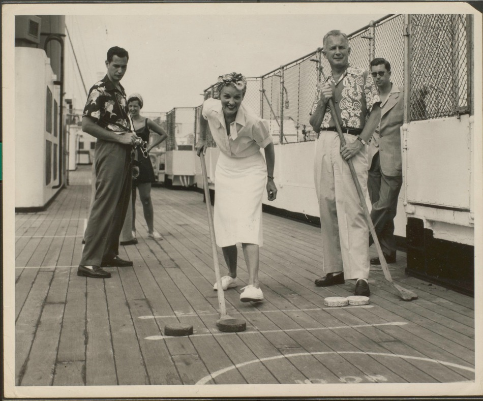 Game of shuffleboard on ship deck