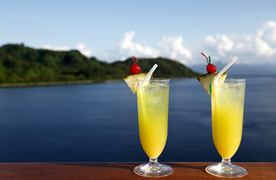 Double Cocktails with Tropical Island in background