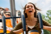scared woman on rollercoaster