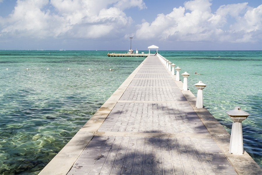 Rum Point dock extends into the blue-green crystal clear waters on the north side of Grand Cayman, Cayman Islands, BWI