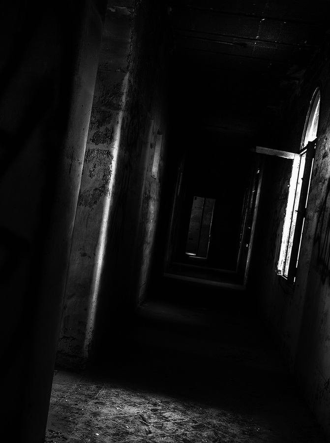 Dark and spooky corridor in an old abandoned building