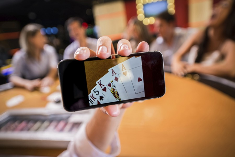 Playing cards online from a cell phone