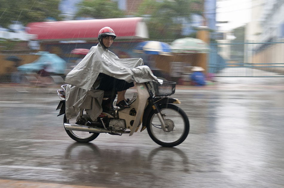 Wearing a poncho on a scooter
