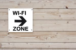 Pointer with Arrow and sign WI-FI ZONE on Wood Wall