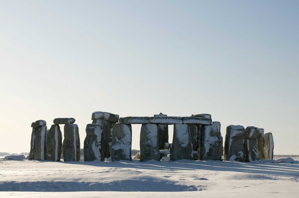 stone henge covered in snow