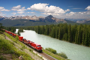 Freight train moving along river
