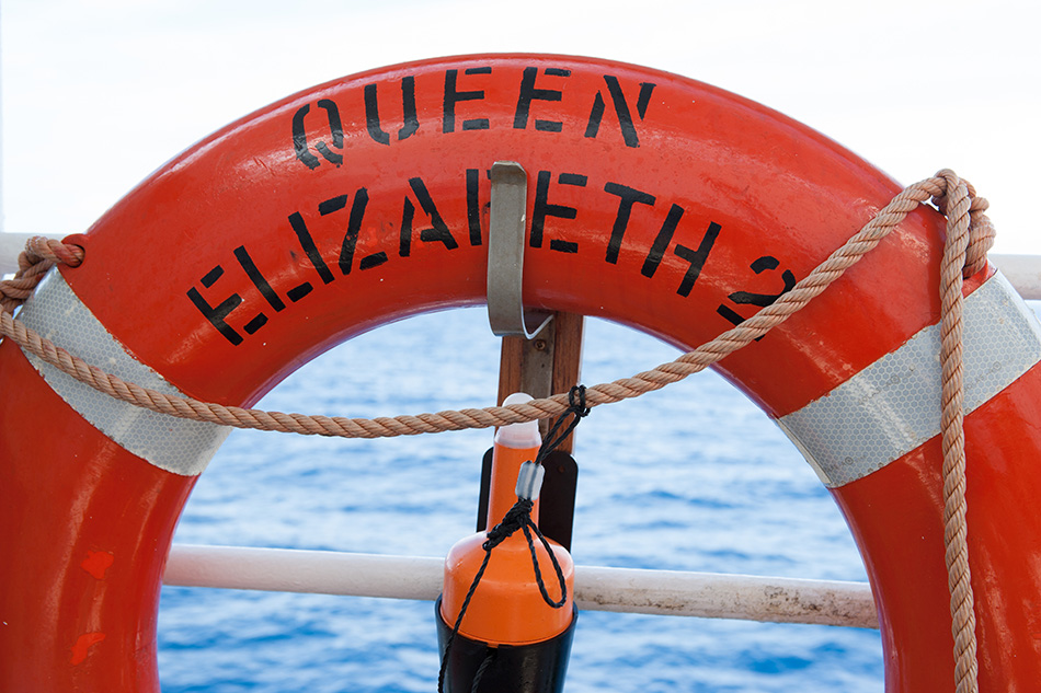 """""""At Sea - October 12, 2005: A life belt from the deck of the Queen Elizebeth 2 ocean liner operated by Cunard.  The QE2 was retired and no longer serves as a cruise ship."""""""