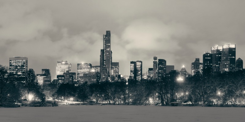 Central Park winter at night panorama with skyscrapers in midtown Manhattan New York City