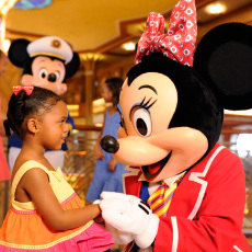 Minnie Mouse with small child